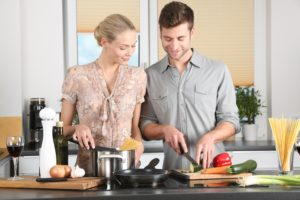 Man and Women using the right Kitchen Countertop for cooking
